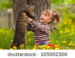 Stock photo funny lovely little girl playing with a cat 105002300