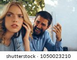 Small photo of blonde with a man, emotions, criticism