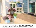 pink flower bouquet in a blue...   Shutterstock . vector #1050027806