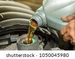 car mechanic replacing and...   Shutterstock . vector #1050045980