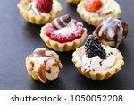 mini dessert tarts sweet... | Shutterstock . vector #1050052208