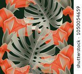 seamless tropical leaves and... | Shutterstock . vector #1050054659