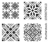 pixel ethnic seamless pattern... | Shutterstock .eps vector #1050070613