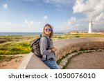 young beautiful female tourist... | Shutterstock . vector #1050076010