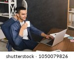 short break for yoga in office. ... | Shutterstock . vector #1050079826