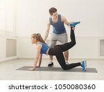 fitness woman training with her ... | Shutterstock . vector #1050080360
