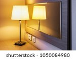 table lamp in the room or hotel ... | Shutterstock . vector #1050084980