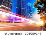 the light trails on the modern... | Shutterstock . vector #105009149