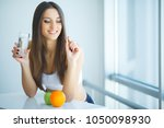 beautiful smiling woman taking... | Shutterstock . vector #1050098930