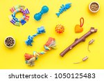Stock photo cats and dogs toys and acessories for pets yellow background top view 1050125483