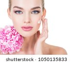 young woman touches cheek by... | Shutterstock . vector #1050135833