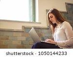 girl using a laptop    Shutterstock . vector #1050144233