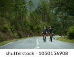 asian couple cycling together... | Shutterstock . vector #1050156908
