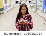 portrait of cute latino girl... | Shutterstock . vector #1050161714