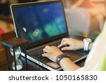 business women are typing... | Shutterstock . vector #1050165830