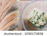 garlic butter ready to be baked ... | Shutterstock . vector #1050173858