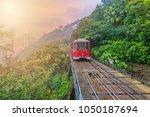 tourist tram at the peak ... | Shutterstock . vector #1050187694
