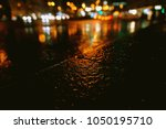 puddle reflection. night city... | Shutterstock . vector #1050195710