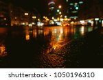 puddle reflection. night city... | Shutterstock . vector #1050196310