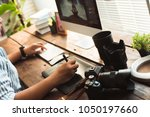 photographers are retouching... | Shutterstock . vector #1050197660