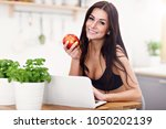 fit smiling young woman with... | Shutterstock . vector #1050202139