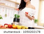 fit smiling young woman... | Shutterstock . vector #1050202178