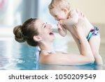 happy mother and her newborn... | Shutterstock . vector #1050209549