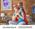 mother and her child playing... | Shutterstock . vector #1050209690