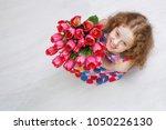 little girl with bouquet of...   Shutterstock . vector #1050226130