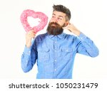 Small photo of Bearded man holds gift and makes call me gesture. Flirt, gesture concept