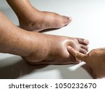 the feet of people with... | Shutterstock . vector #1050232670
