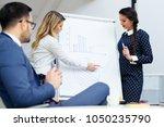 business woman showing a... | Shutterstock . vector #1050235790