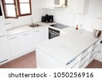 modern white kitchen in a... | Shutterstock . vector #1050256916