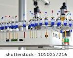 autosampler of nmr spectrometer ...   Shutterstock . vector #1050257216