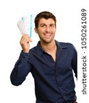 young man holding boarding pass ... | Shutterstock . vector #1050261089
