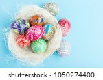 colorful shiny easter eggs in... | Shutterstock . vector #1050274400