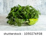 green parsley and dill in a... | Shutterstock . vector #1050276938