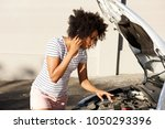 portrait of young african woman ... | Shutterstock . vector #1050293396