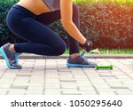 sports concepts   woman tying... | Shutterstock . vector #1050295640