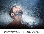 headshot of a handsome...   Shutterstock . vector #1050299768