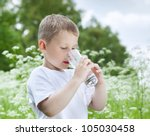 child drinking pure water in...   Shutterstock . vector #105030458