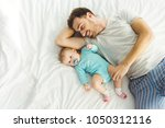 high angle view of young father ... | Shutterstock . vector #1050312116