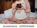 the future mother drinking a... | Shutterstock . vector #1050324668