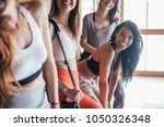 young women laughing after... | Shutterstock . vector #1050326348