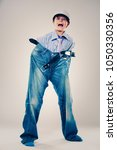 caucasian boy wearing his dad's ... | Shutterstock . vector #1050330356