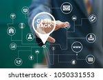 businessman pushing button cash ... | Shutterstock . vector #1050331553