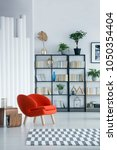 orange armchair standing in a... | Shutterstock . vector #1050354404
