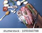 meat on the board. preparation... | Shutterstock . vector #1050360788
