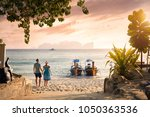 happy couple on the tropical... | Shutterstock . vector #1050363536