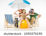 family in swimming goggles with ... | Shutterstock . vector #1050370190